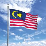 Malaysia Flying High. Malaysia flag flying in the sky Stock Images
