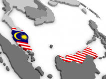 Malaysia on globe with flag Royalty Free Stock Photography