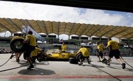 Malaysia-Grubenbesatzung-Praxisreifenänderung des Team-A1 Lizenzfreies Stockbild