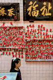 Malaysia, in Kuala Lumpur during Chinese new year in the Sin Sze Si Ya Temple. The walls of the temple are covered with votive papers royalty free stock photo