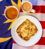 Malaysia-Lebensmittel - roti canai und der Tarik, sehr berühmtes Getränk und Stockbilder