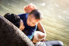 Malaysian mother holds her baby close to her chest royalty free stock photography