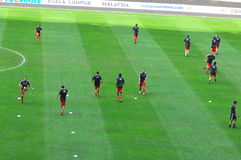 Malaysia and Liverpool football team. Kuala Lumpur July 16th : The picture shows the Liverpool team in warm up session The match is part of the Liverpool Asia Royalty Free Stock Image