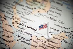 Malaysia marked with a flag on the map.  stock photography