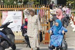 Malaysia medborgare framme av rollbesättningmitten Royaltyfria Bilder