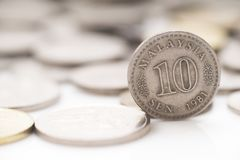 Malaysia money 10 cent old coin stand 1981. Malaysia coins with 1 malaysia old coins standing , 1981 old collection coin royalty free stock photo