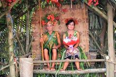 Malaysia Multi Ethnic Wedding Exhibition. KUALA LUMPUR, MALAYSIA - NOVEMBER 28: The ethnic orang asli (aboriginal peoples) of Malay wearing traditional cloth at Stock Image