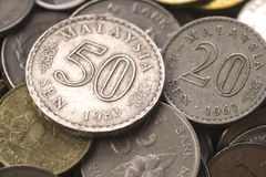 Malaysia old coin collection. Malaysia old coin 50 cent 1983 20 cent 1967 sen and other coin as background Stock Photos