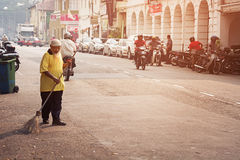 MALAYSIA, PENANG, GEORGETOWN - CIRCA JUL 2014: Old man sweeping Stock Photo