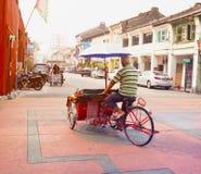MALAYSIA, PENANG, GEORGETOWN - CIRCA JUL 2014: A pedicab driver Stock Image