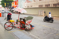 MALAYSIA, PENANG, GEORGETOWN - CIRCA JUL 2014: Pedicab parked on Stock Image