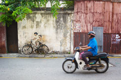 MALAYSIA, PENANG, GEORGETOWN - CIRCA JUL 2014: Real bicycle juxt Royalty Free Stock Photo