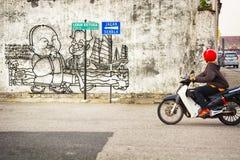 MALAYSIA, PENANG, GEORGETOWN - CIRCA JUL 2014: A simple mural ex Stock Photography