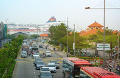 MALAYSIA, PENANG, GEORGETOWN - CIRCA JUL 2014: Traffic flows awa Royalty Free Stock Images