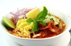 Malaysia Popular Laksa Assam Penang. In a White Bowl served with traditional condiments stock photography