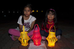 Malaysia's celebrate Earth Hour 2011. KUALA LUMPUR, MALAYSIA-MAR 26:Asirah 10 years old and Adriana 5 years old with their lantern during Earth Hour Campaign at Royalty Free Stock Photo