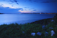Malaysia skyline, sunset. The Malaysia skyline in the distance, viewed during sunset in Singapore from Kranji across the sea Royalty Free Stock Images