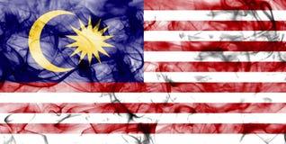 Malaysia smoke flag isolated on a white background. Malaysia smoke flag isolated on a white background Stock Photos