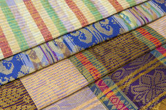 Malaysia Songket. Songket is a fabric that belongs to the brocade family of textiles of Indonesia, Malaysia and Brunei. It is hand-woven in silk or cotton Stock Images