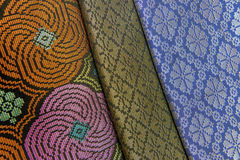 Malaysia Songket. Songket is a fabric that belongs to the brocade family of textiles of Indonesia, Malaysia and Brunei. It is hand-woven in silk or cotton Stock Image