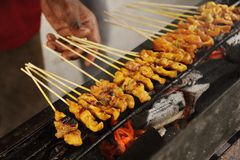 Malaysia Spicy Satay. Spicy food being BBQ tradtional asian cuisine preparation, Satay (bamboo stick skewered barbequed meat stock photo