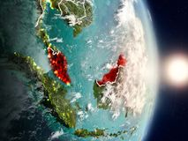 Malaysia during sunrise. Highlighted in red on planet Earth with visible country borders. 3D illustration. Elements of this image furnished by NASA Stock Images