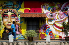 MALAYSIA TRAVEL MALACCA. A visitor walks by a graffiti in the bank of Malacca River, Bandar Hilir, Malacca, Malaysia.  It was listed as Malaysia's UNESCO World Stock Photo