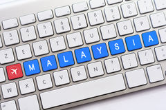 MALAYSIA writing on white keyboard with a aircraft sketch Royalty Free Stock Photo
