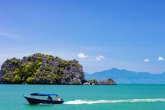 Malaysian boat near beach on the island of Langkawi stock photos