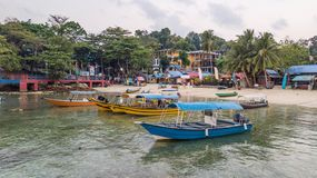 Malaysian boats in front of a tropical beach in Pulau Perhentian Kecil in Malaysia. Romantic travel destination for couples in royalty free stock photo