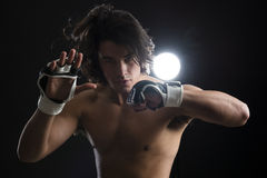 Malaysian boxer fighting Stock Photo