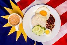 Malaysian Breakfast - Nasi Lemak and Teh Tarik on Malaysia Flag. Stock Images