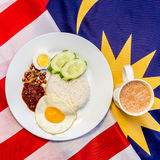 Malaysian Breakfast - Nasi Lemak and Teh Tarik on Malaysia Flag. Royalty Free Stock Photo
