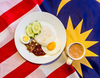 Malaysian Breakfast - Nasi Lemak and Teh Tarik on Malaysia Flag. Stock Photography