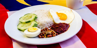 Malaysian Breakfast - Nasi Lemak and Teh Tarik on Malaysia Flag. Stock Image