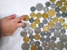 Malaysian coins. Over white background. Its a personal collection for home savings stock photography