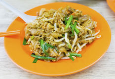 Malaysian cuisine. Char Kway Teow. Is a flat rice noodles stir fried together with pork lard, egg, soy sauce, bean sprouts and Chinese chives royalty free stock photography