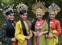 Malaysian Cultural Entire. Traditional and modern contemporary malaysian cultural outfit entire songket textile`s and head gears Royalty Free Stock Image