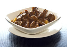 Malaysian curry beef. On white plate stock images