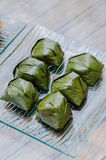 Malaysian dessert wrapped with banana leave Stock Image