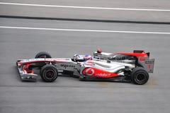 Malaysian F1 Grand Prix -Jenson Button. Jenson Button of Vodafone McLaren Mercedes speeding during Petronas Malaysian F1 Grand Prix at Sepang F1 Circuit April 4 Stock Photography
