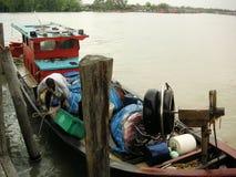 Malaysian fishing boat. Traditional malaysian fisihng boat, docking at Kuala Selangor, Malaysia royalty free stock photos