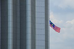Malaysian flag. A malaysian flag on a skyscraper Royalty Free Stock Image