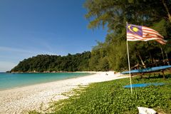 Malaysian flag at a quiet beach Stock Image