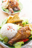Malaysian food nasi ayam penyet. Famous traditional Malay food. Delicious nasi ayam penyet with sambal belacan. Local flavor. Fresh hot with steam smoke royalty free stock photo