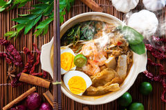 Malaysian food. Prawn mee, prawn noodles. Popular Malaysian food spicy fresh cooked har mee in clay pot with hot steam. Asian cuisine Stock Images