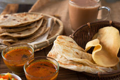 Malaysian food. Roti canai, Chapati or Flat bread, teh tarik or milk tea and curry, famous Malaysian Indian food stock images