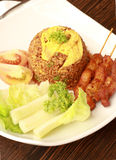 Malaysian Fried Rice. Fried Rice with Chicken Satay Royalty Free Stock Photo