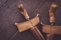 Malaysian heritage, antique malay dagger or Keris on wooden floor. Low light shot, image may contain grain stock photo