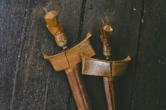 Malaysian heritage, antique malay dagger or Keris on wooden floor. Low light shot, image may contain grain royalty free stock photo